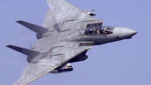 An F-14 Tomcat flying with its wings swept back