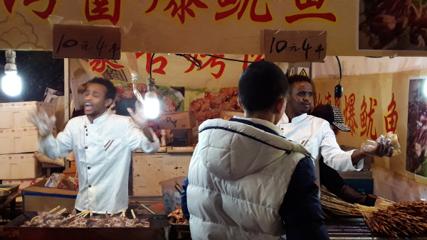 Black dudes BBQing in Tianhe Flower Market for Chinese New Year 2016