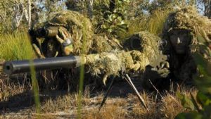 A sniper team focusing on their target
