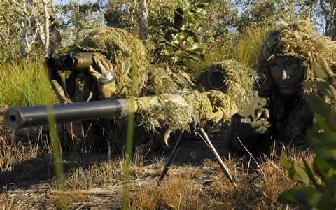 A sniper team focusing on their target