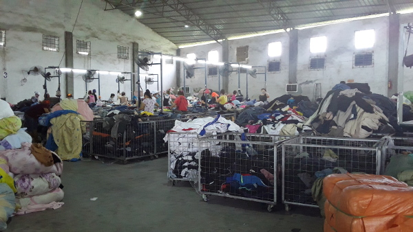 Africans sorting clothes in Baiyun sweatshop